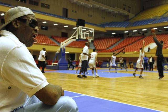 Dennis Rodman watches court side as North Korean and U.S. basketball players practice in Pyongyang, North Korea on Tuesday, Jan. 7, 2014. Rodman came to the North Korean capital with a squad of U. ...