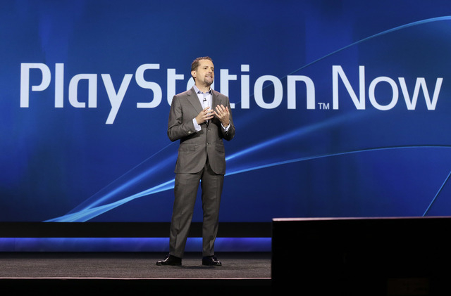 Sony president and group CEO of computer entertainment, Andrew House, speaks about streaming Play Station games during a keynote address at the International Consumer Electronics Show, Tuesday, Ja ...