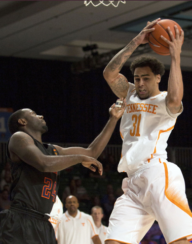 In this Nov. 28, 2013 file photo, Tennessee's Quinton Chievous, right, pulls down a rebound as UTEP's Justin Crosgile watches during the first half of a game in Paradise Island, Bahamas. UTEP offi ...