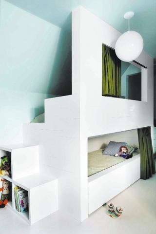 This photo provided by Brian Patrick Flynn shows architectural bunk beds by Interior designer Flynn who says that bunk rooms are becoming more and more popular with homeowners who have awkward bon ...