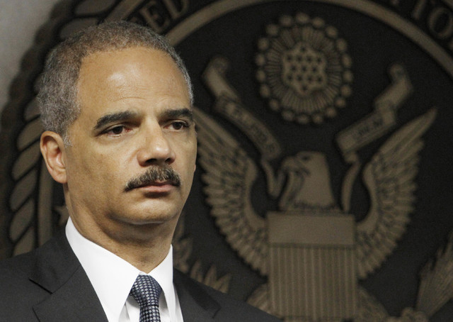 FILE - In this July 16, 2010 file photo, Attorney General Eric Holder takes part in news conference in Miami. The Obama administration is issuing new recommendations Wednesday Jan. 8, 2014 on clas ...