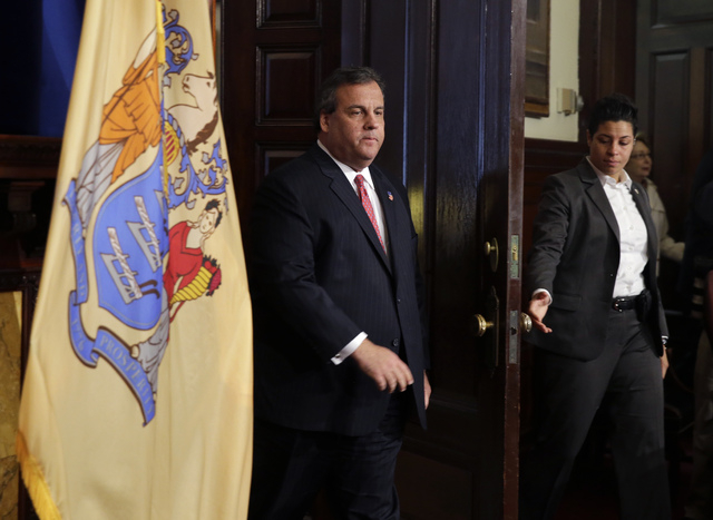 New Jersey Gov. Chris Christie enters a news conference Thursday, Jan. 9, 2014, at the Statehouse in Trenton, N.J.  Christie has fired a top aide who engineered political payback against a town ma ...
