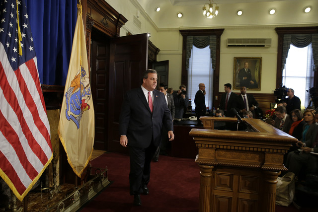 New Jersey Gov. Chris Christie walks to the podium before a news conference Thursday, Jan. 9, 2014, at the Statehouse in Trenton, N.J.  Christie has fired a top aide who engineered political payba ...