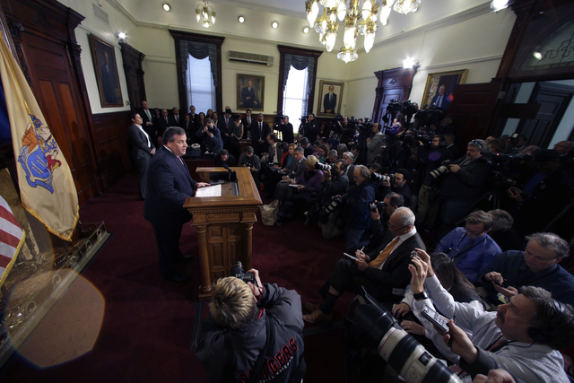 New Jersey Gov. Chris Christie speaks during a news conference Thursday, Jan. 9, 2014, at the Statehouse in Trenton, N.J.  Christie has fired a top aide who engineered political payback against a  ...
