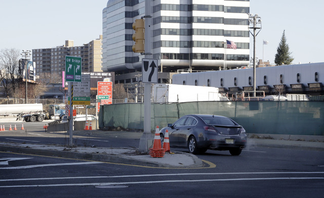 A car uses an onramp to the George Washington Bridge toll plaza in Fort Lee, N.J.,  Thursday, Jan. 9, 2014. The onramp was closed for three days in September 2013 snarling traffic at one of the wo ...