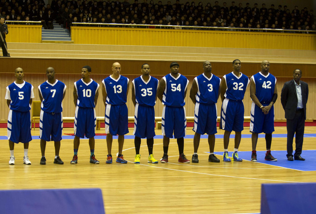 """U.S. basketball players line up before an exhibition basketball game at an indoor stadium in Pyongyang, North Korea on Wednesday, Jan. 8, 2014. From left to right are Andre """"Silk"""" Poole, ..."""