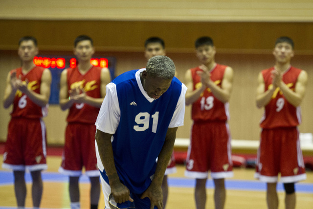 Dennis Rodman bows to North Korean leader Kim Jong Un, seated above in the stands, after singing Happy Birthday to Kim before an exhibition basketball game with U.S. and North Korean players at an ...