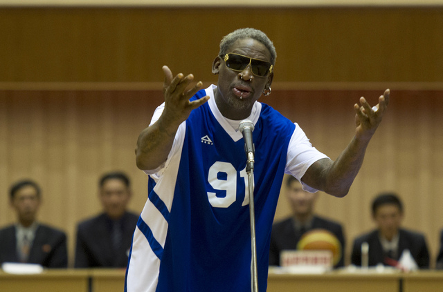 Dennis Rodman sings Happy Birthday to North Korean leader Kim Jong Un, seated above in the stands, before an exhibition basketball game at an indoor stadium in Pyongyang, North Korea on Wednesday, ...