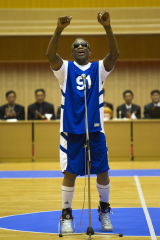 Dennis Rodman sings Happy Birthday to North Korean leader Kim Jong Un, seated above in the stands, before an exhibition basketball game with U.S. and North Korean players at an indoor stadium in P ...