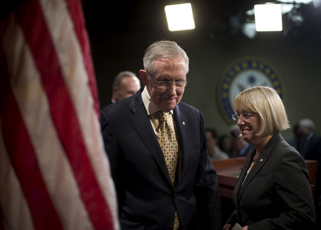 Sen. Majority Leader Harry Reid, D-Nev., center, walks Thursday with Sen. Patty Murray, D-Wash., right, and Sen. Charles Schumer, D-N.Y., left, after a news conference on Capitol Hill in Washingto ...