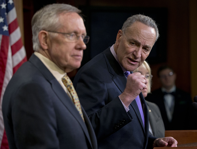From left, Sen. Majority Leader Harry Reid, D-Nev., Sen. Charles Schumer, D-N.Y., and Sen. Patty Murray, D-Wash., hold a news conference on Capitol Hill in Washington on Thursday about extending u ...