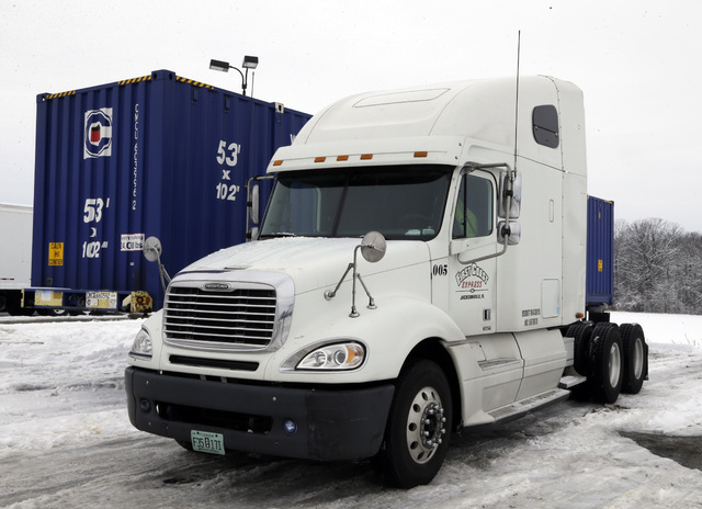 This is the tractor trailer that Tim Rutledge, 53, of Orlando, Fla., says he crawled under before dawn Monday to fix its frozen brakes when it suddenly settled deeper into the snow, pinning him be ...