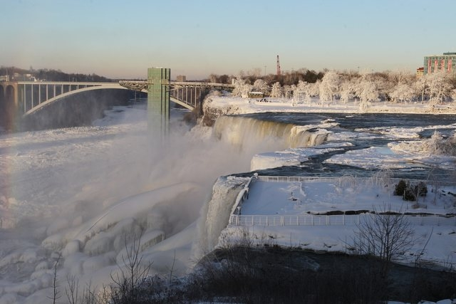 The area surrounding Niagara Falls is coated in a layer of ice in Niagara Falls State Park, Niagara Falls, N.Y. on Thursday, Jan. 9, 2014.  Niagara Falls hasn't frozen over, but it has become an i ...