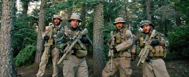 This photo released by Universal Pictures shows, from left, Taylor Kitsch, as Michael Murphy, Mark Wahlberg as Marcus Luttrell, Ben Foster as Matt Axe Axelson, and Emile Hirsch as Danny Dietz in a ...
