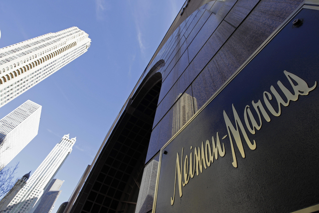 In this Wednesday, March 11, 2009 file photo, the Chicago skyline is reflected in the exterior of Neiman Marcus on Michigan Avenue in Chicago. Neiman Marcus confirmed Saturday, Jan. 11, 2014 that  ...