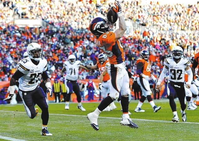 Denver Broncos wide receiver Wes Welker (83) catches a pass for a touchdown against the San Diego Chargers in the second quarter of an NFL AFC division playoff football game, Sunday, Jan. 12, 2014 ...