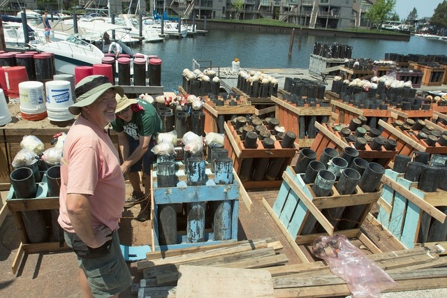 Chuck Amalong, left, and Brent Mattix help prepare Lake Tahoes Fourth of July fireworks display at Tahoe Keys Marina in Lake Tahoe, Calif. A federal lawsuit accusing the Lake Tahoe Visitors Author ...
