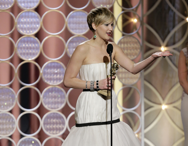 """Jennifer Lawrence, left, accepts the award for best supporting actress in a motion picture for her role in """"American Hustle"""" during the 71st annual Golden Globe Awards on Sunday. (AP Photo/NBC, Pa ..."""
