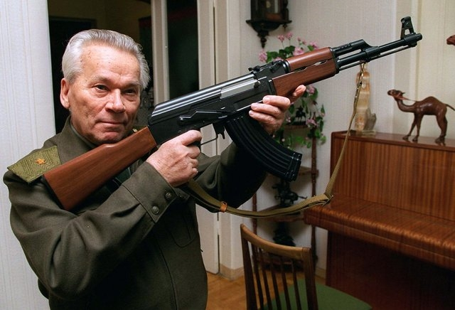 Mikhail Kalashnikov shows a model of his world-famous AK-47 assault rifle at home in the Ural Mountain city of Izhevsk, 625 miles east of Moscow in this Oct. 29, 1997 file photo. The designer of t ...