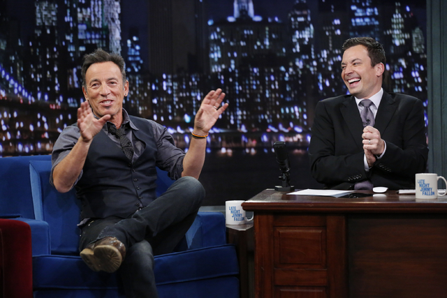 """This image released by NBC shows Bruce Springsteen, left, with host Jimmy Fallon  during an appearance on """"Late Night with Jimmy Fallon,"""" on Tuesday, Jan. 14, 2014 in New York. (AP Photo ..."""