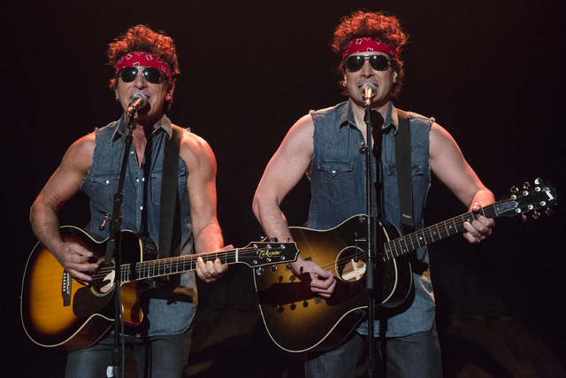 """This image released by NBC shows Bruce Springsteen, left, and Jimmy Fallon performing during """"Late Night with Jimmy Fallon,"""" on Tuesday, Jan. 14, 2014 in New York. (AP Photo/NBC, Lloyd B ..."""