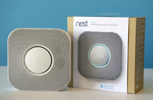 The Nest Labs smoke and carbon monoxide alarm is shown at the company's offices in Palo Alto, Calif. Google said Monday it will pay $3.2 billion to buy Nest Labs, which develops high-tech versions ...