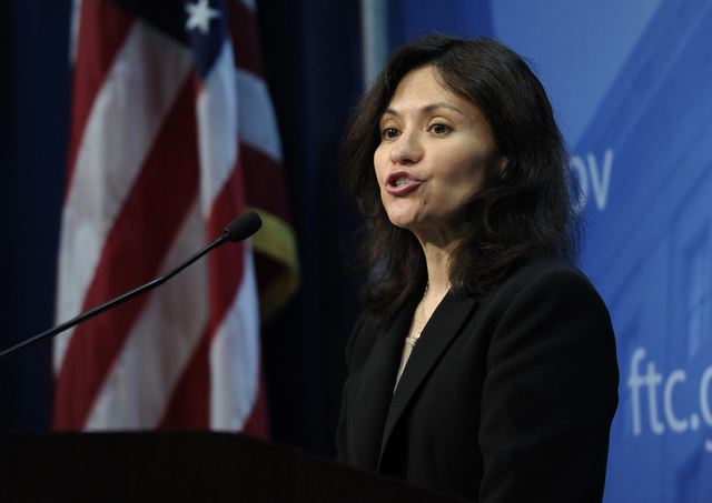 Federal Trade Commission (FTC) Chair Edith Ramirez speaks at the FTC in Washington, Wednesday, Jan. 15, 2014, where she announced Apple will refund $32.5 million to consumers to settle a federal c ...