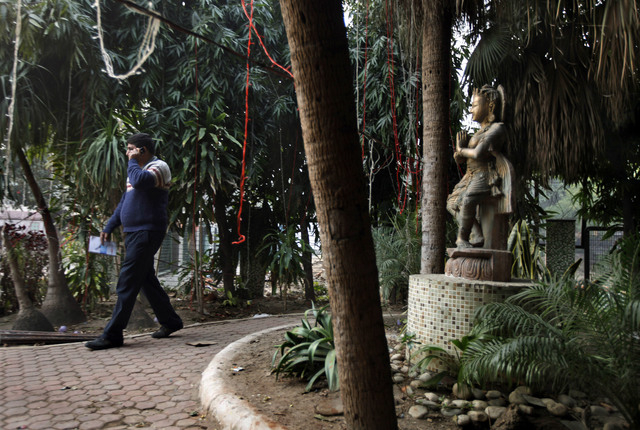 An Indian investigator speaks on his phone Wednesday at the spot where police say a Danish tourist was gang-raped in New Delhi. The 51-year-old tourist was attacked Tuesday near a popular shopping ...