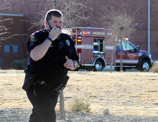 Law enforcement personnel set up a perimeter after a shooting at Berrendo Middle School, Tuesday, Jan. 14, 2014, in Roswell, N.M. A shooter opened fire at the middle school, injuring at least two  ...