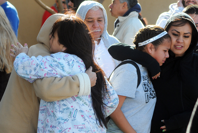 Students are reunited with families at a staging ground area set up at the Roswell Mall following a shooting at Berrendo Middle School, Tuesday, Jan. 14, 2014, in Roswell, N.M. A shooter opened fi ...