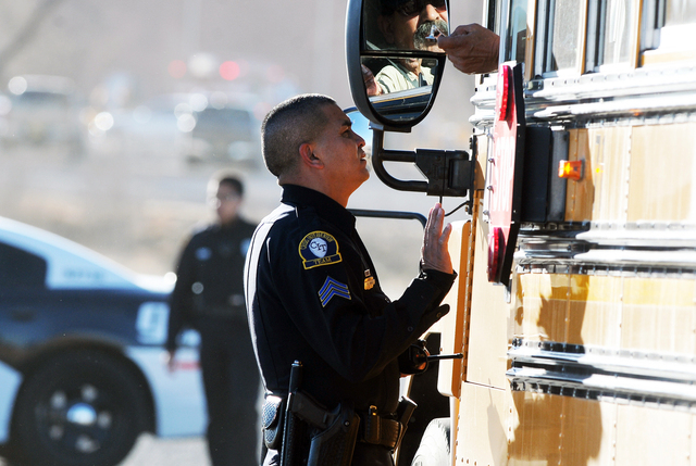 Law enforcement personnel set up a perimeter following a shooting at Berrendo Middle School, Tuesday, Jan. 14, 2014, in Roswell, N.M. Roswell police said the suspected shooter was arrested at the  ...