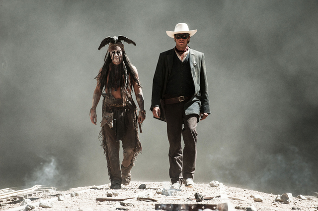 "This undated publicity photo released by Disney and Jerry Bruckheimer, Inc. shows Johnny Depp, left, as Tonto, and Armie Hammer, as The Lone Ranger, in a scene from the film, ""The Lone Ranger ..."