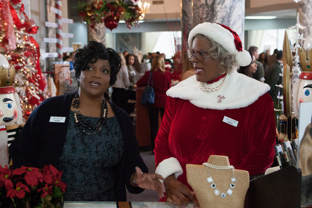 "This image released by Lionsgate shows Anna Maria Horsford, left, and Tyler Perry in a scene from ""Tyler Perry's A Madea Christmas. (AP Photo/Lionsgate, KC Bailey)"