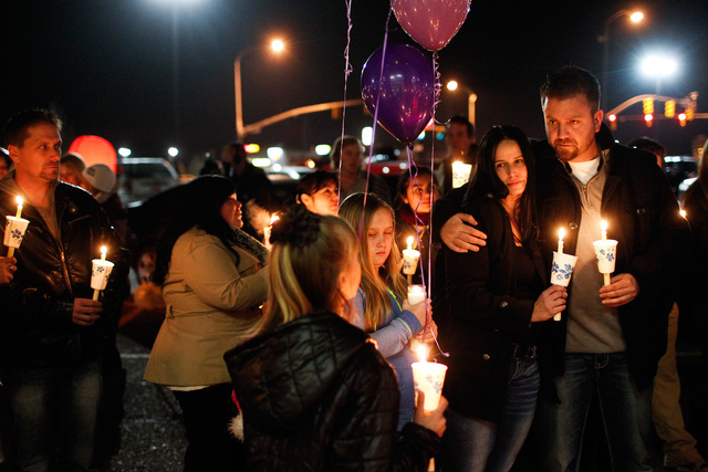 People gather during a memorial service and candlelight vigil for the Boren family at the Gold's Gym in Spanish Fork, Utah, on Saturday. Authorities believe Joshua Boren, a police officer, shot an ...