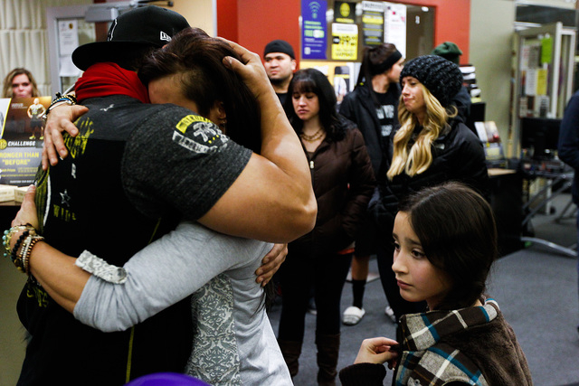 Telmo Torres, left, hugs RiRi Whiting, both friends of Kelly Boren, during a memorial service and candlelight vigil for the Boren family at the Gold's Gym in Spanish Fork, Utah, on Saturday. Autho ...
