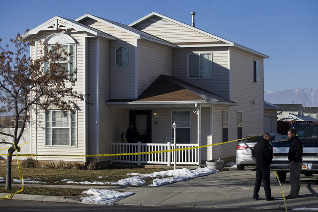 Investigators put police tape in front of a home on Friday in Spanish Fork, Utah, where five people were found dead on Thursday.  A 34-year-old Lindon police officer shot and killed his wife, moth ...
