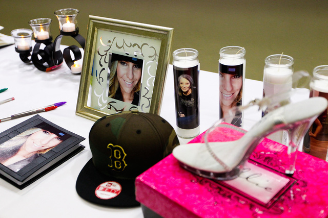 Photos and mementos are left on a table during a memorial service and candlelight vigil for the Boren family at the Gold's Gym in Spanish Fork, Utah, on Saturday. Authorities believe Joshua Boren, ...