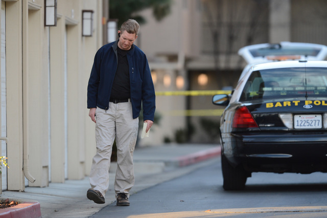 Law enforcement officers investigate the accidental fatal shooting of a Bay Area Rapid Transit police officer by a fellow BART officer while serving a warrant at an apartment building, according t ...