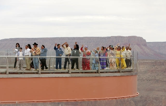 Members of the Hualapai Indian tribe walk along the Grand Canyon Skywalk during the grand opening ceremony of the attraction in 2007. On Thursday, a federal judge upheld a $28.5 million judgment i ...