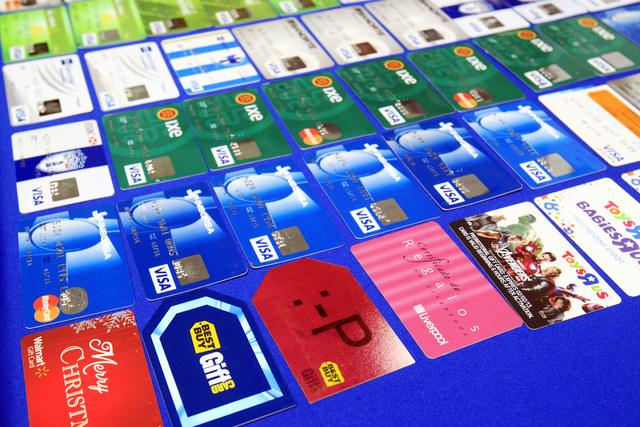 Credit cards that were confiscated are displayed at the McAllen Police Department in McAllen, Texas, after police arrested a man and a woman on fraud charges on Monday. According to a South Texas  ...