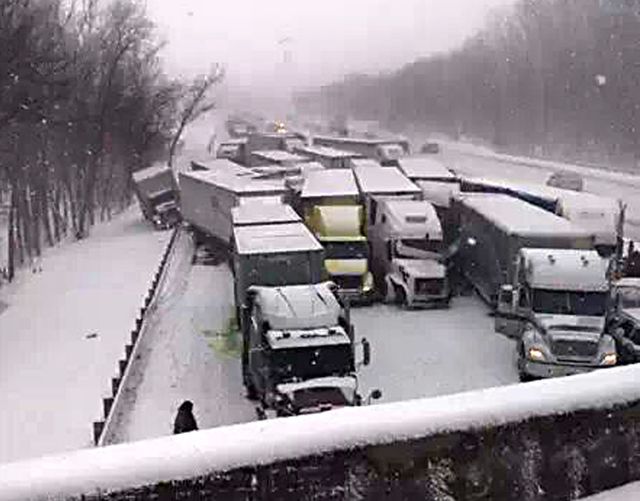 This cell phone image shows a massive highway pileup on Interstate 94 near Michigan City, Ind., Thursday, Jan. 23, 2014, that is being blamed on whiteout conditions. The accident has left at least ...