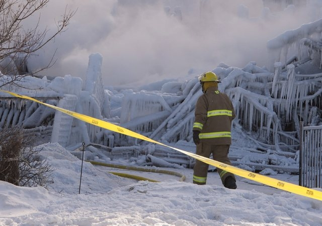 Firefighters work at the scene of a senior's residence fire on Thursday, Jan. 23, 2014 in L'Isle-Verte, Quebec.   The fire raged through the seniors' residence, killing at least three people and l ...