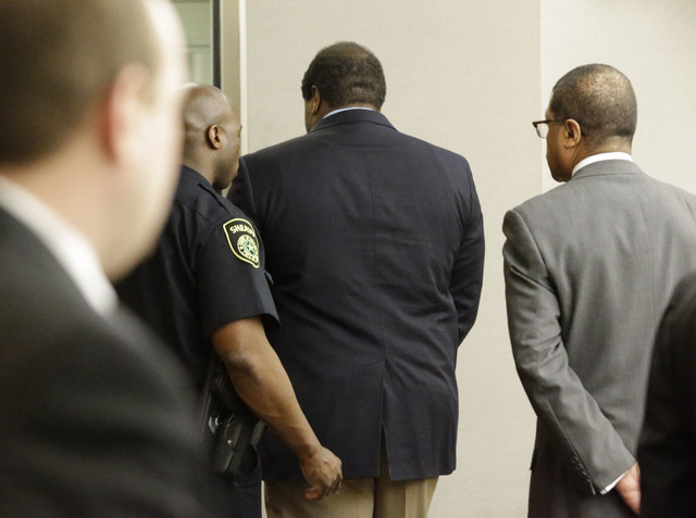 Former Dallas Cowboys NFL football player Josh Brent, center, is lead away from court into custody after his sentencing in his intoxication manslaughter trial Friday, Jan. 24, 2014, in Dallas.  Br ...