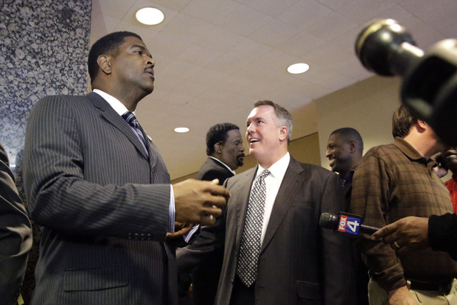 Defense lawyer George Milner III, right, smiles as Dallas County prosecutor Heath Harris, left, takes his turn to speak to gathered reporters after the sentencing in former Dallas Cowboys NFL foot ...