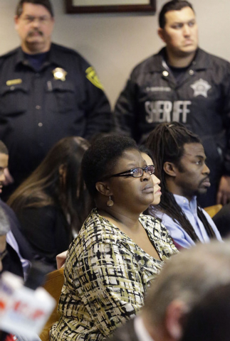 LaTasha Brent, center front, the mother of former Dallas Cowboys NFL football player Josh Brent, sits in court and listens while the sentenncing for her son's intoxication manslaughter conviction  ...