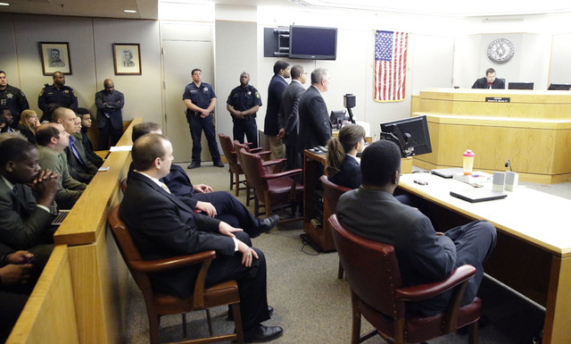 A packed courtroom listens to Judge Robert Burns III, right, admonish former Dallas Cowboys Josh Brent as he stands with his lawyers after Brent's sentencing for his intoxication manslaughter conv ...