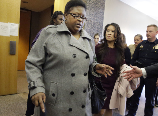 LaTasha Brent, the mother of former Dallas Cowboys NFL football player Josh Brent, is helped from the court after the punishment for her son's intoxication manslaughter conviction was read Friday, ...
