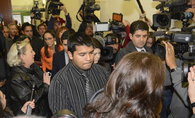 Erick Munoz, husband of Marlise Munoz, is escorted out of court by his attorney Heather L. King, right,  Friday, Jan. 24, 2014 in Fort Worth, Texas.  The court ruled in Munoz's favor and to remove ...