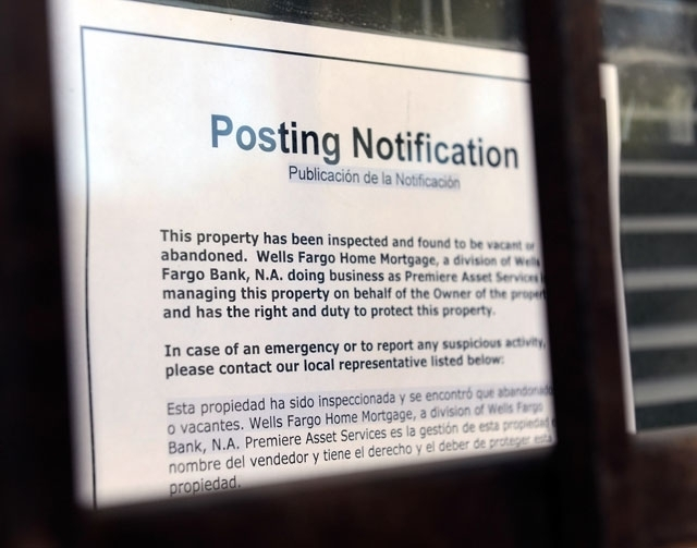 A foreclosure notice is posted on the window at a small condominium complex in Las Vegas in this 2012 file photo. (Review-Journal File Photo)
