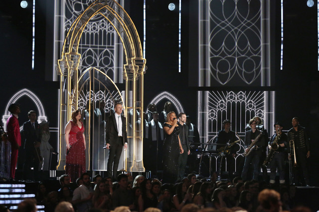 "Mary Lambert, from left foreground, Macklemore and Queen Latifah perform ""Same Love' on stage at the 56th annual Grammy Awards at Staples Center on Sunday, Jan. 26, 2014, in Los Angeles. (Pho ..."